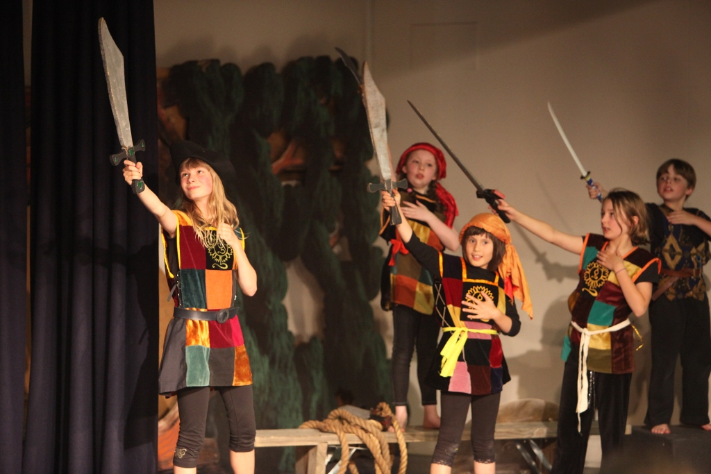Children, dressed as pirates, perform Grace O'Malley.